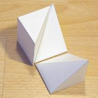 Paper model three pyramids that form a cube